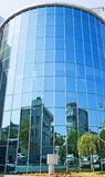 Large curved glass building Stock Photo