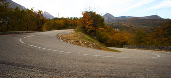 Large curved road in mountain Stock Images