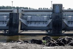 Large dam barrier. Gray concrete stock image