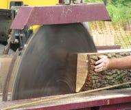 Large dangerous looking circular saw cutting wood Royalty Free Stock Image