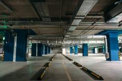 Underground garage or modern car parking. Large dark empty Underground garage or modern car parking, columns, tunnel vision, toned Stock Images