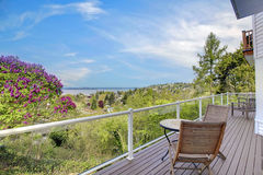 Large deck with furniture and water view. Royalty Free Stock Images