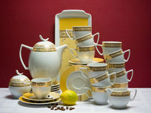 Large decorated china tea-set with coffee beans Stock Image