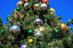 Large decorated Christmas tree in the courtyard of the residential complex, shimmer decorations in the sun. Bottom view stock images