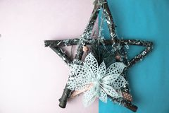 Large decorative beautiful wooden Christmas star, a self-made advent wreath fir branches and sticks on the festive New Year happy royalty free stock photography