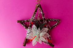 Large decorative beautiful wooden Christmas star, a self-made advent wreath of fir branches and sticks on the festive New Year stock image