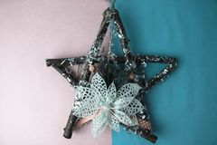Large decorative beautiful wooden Christmas star, a self-made advent wreath fir branches and sticks on the festive New Year happy royalty free stock photo