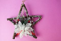 Large decorative beautiful wooden Christmas star, a self-made advent wreath of fir branches and sticks on the festive New Year royalty free stock photos