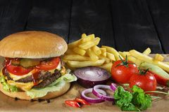 Large delicious heavy burger Royalty Free Stock Photo