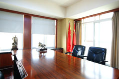 Large Desk in Office with Chinese Flags Stock Photo