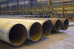 Large diameter pipes are in an industrial workshop Stock Photos