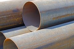 Large diameter steel pipes. Large diameter rusty steel pipes stock image