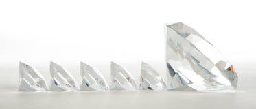 Large diamond leading small ones Royalty Free Stock Image