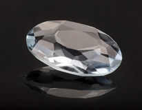 Large diamond with reflection on black Stock Image