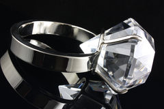 Large diamond ring. Diamond ring on black background stock photo