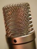 Large diaphragm microphone macro. Macro abstract photo of a large diaphragm studio microphone. Shallow depth of field Royalty Free Stock Photos