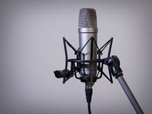 Large diaphragm microphone. Photo of a large diaphragm studio microphone on a mic stand Royalty Free Stock Photography