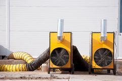 Free Large Diesel Heaters At A Construction Site. Equipment For Heating A Room In A Cold Period Of Time Stock Image - 162610621