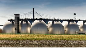 Large digestion towers for the treatment of wastewater at the edge of the port stock image