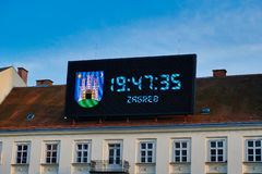 Large Digital Clock on Historic Building, Zagreb, Croatia. A large LED digital clock billboard mounted on an historic building in central Zagreb Old Town stock images