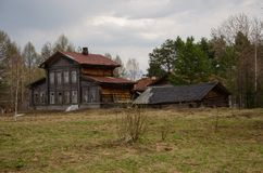 Large, dilapidated wooden house in a forest glade Royalty Free Stock Photography