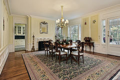 Large dining room with fireplace Stock Image