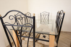 Large dining table and chairs in a house Royalty Free Stock Images