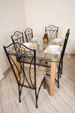 Large dining table and chairs in a house Royalty Free Stock Photography