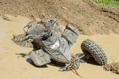 Large dirty ATV stuck in a puddle on a forest road Stock Photo
