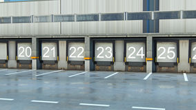 A Large distribution warehouse with gates for loading goods Stock Photography