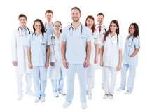 Large diverse group of medical staff in uniform stock photo