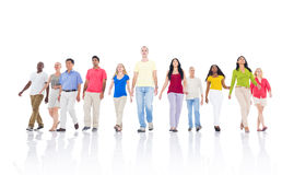 Large Diverse Group of People Walking Stock Images