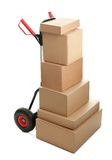 Large dolly with brown shipping boxes Stock Images