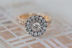 Round halo diamond wedding engagement ring on white background stock photography