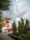 A large dragon building in the garden while the sky is near to rain royalty free stock photography