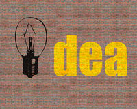 Large drawing lamp and idea word on huge bricks wall. In day Royalty Free Stock Photography