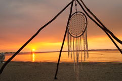 Large dreamcatcher on the beach at sunset or twilight Royalty Free Stock Photos
