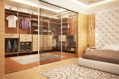 Large dressing room in the bedroom. Large walk-in closet in modern bedroom stock image