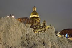 Large drifts of snow on the background of St. Isaac's Cathedral Royalty Free Stock Photo