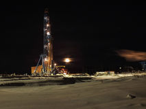A large drilling rig at night. Drilling rig moon Oilfield night industries. Stock Image