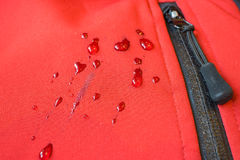 Large drops of water on waterproof clothes. zippers pocket fastener stock images