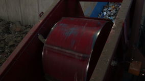 A Large Drum Crushing Cans at a Recycling Center. A view of Recycling aluminum cans stock footage