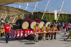Large drums on a cartwheel on the Japanese traditional parade on EXPO 2015 Stock Photography