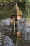 A large duck house in the wildfowl sanctuary in Ward Park in Bangor County Down in Northern Ireland. A large duck house in the pond of the wildfowl sanctuary in Stock Image