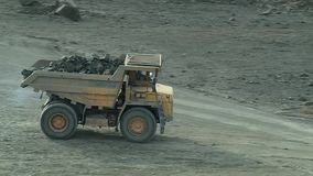 Dumper in a stone quarry. A large dump truck is moving along a stone quarry stock footage