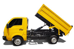 Large dump truck. Dump truck with shadow isolated on white background Stock Photos
