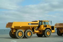 Large dumper trucks. Working in industrial site Royalty Free Stock Image