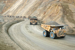 Convoy of Large dumptruck in copper mine Royalty Free Stock Photos