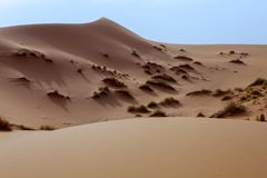 Large dunes in the Sahara deformed by the wind, Morocco Royalty Free Stock Photo