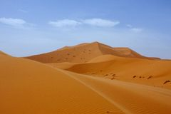 Large dunes in the Sahara deformed by the wind, Morocco Stock Image